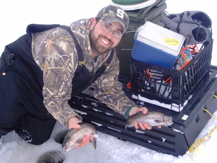Ice Fisherman with two Rainbow trout