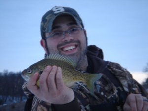 Ice Fisherman with a Bluegill