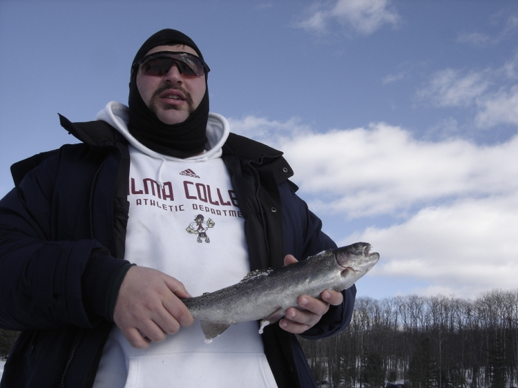 Ice fisherman with a trout