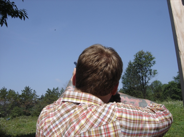Graw shooting at an airborn clay target
