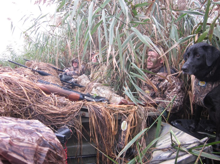 Duck boat in the weeds with hunters