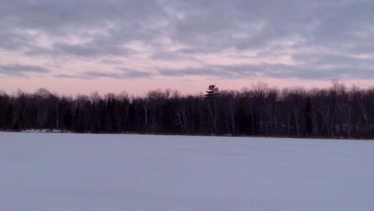 sunrise from a frozen lake