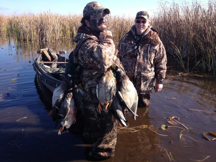 Hunters with Ducks